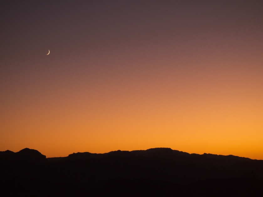 the new moon chases the setting sun